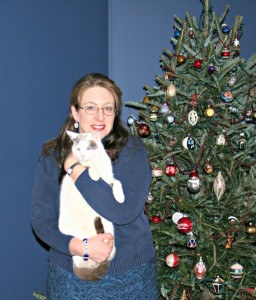 Yes, it's me, your intrepid blogger, with Whitey, one of our 5 cats.