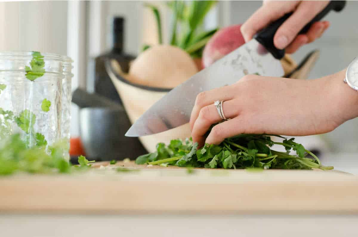 a woman chopping fines herbes